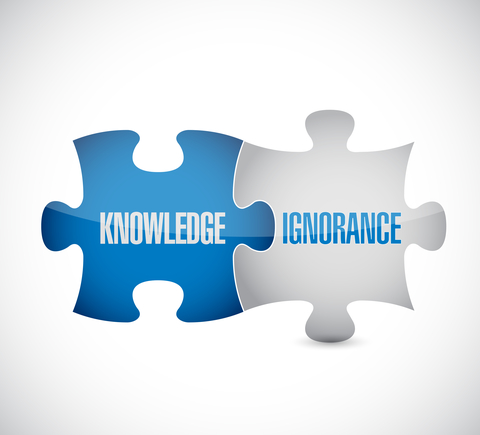 knowledge and ignorance puzzle pieces sign
